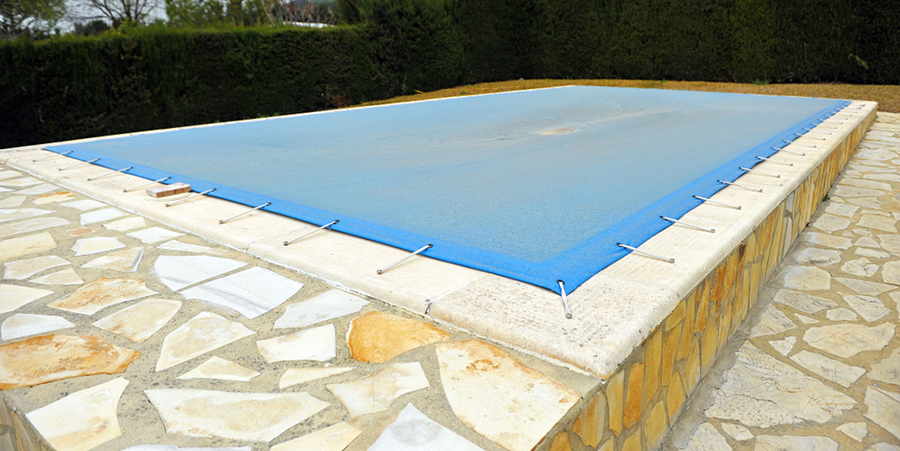 pool covered with blue tarp