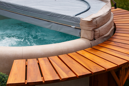 wood and leather circular hot tub with cover
