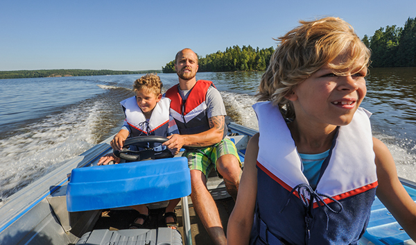family-riding-open-water-lifejackets